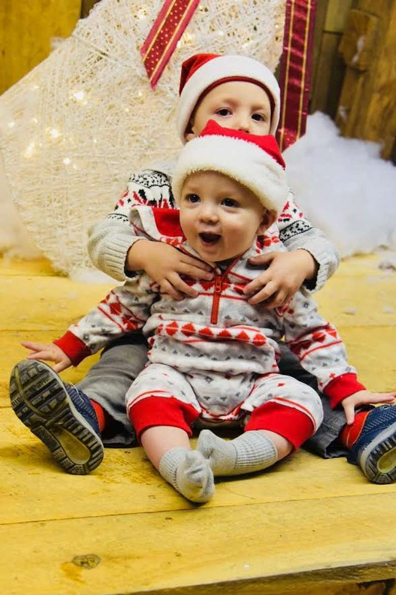 two toddlers dressed for holidays