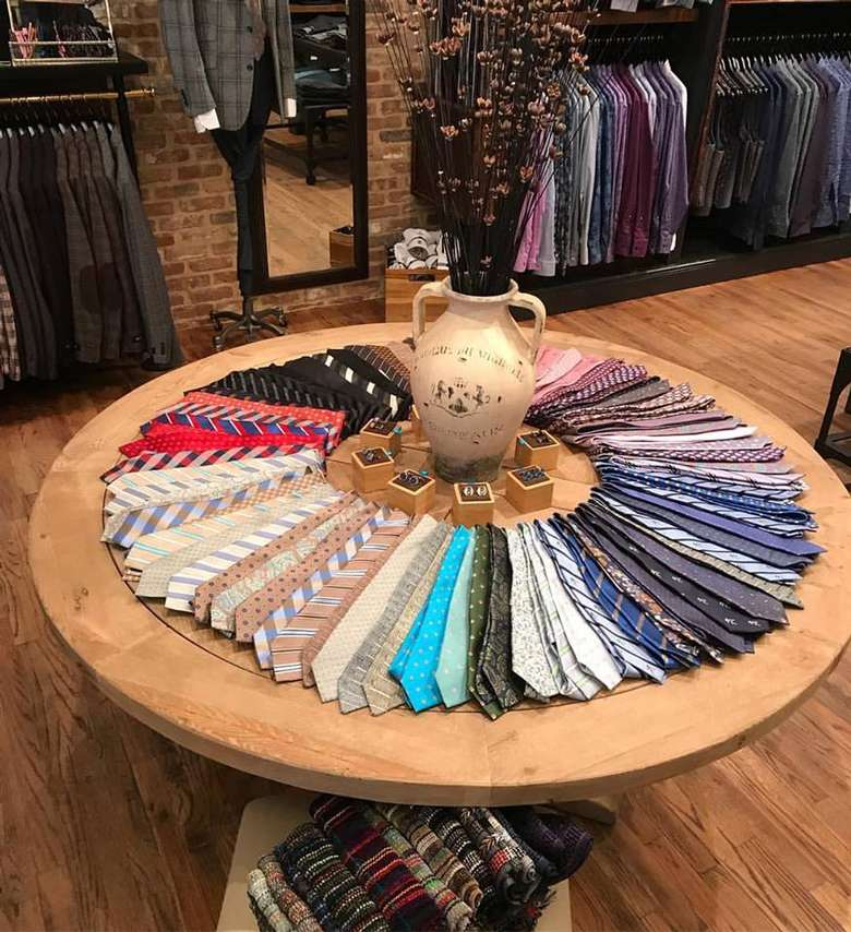 colorful ties displayed on a round table