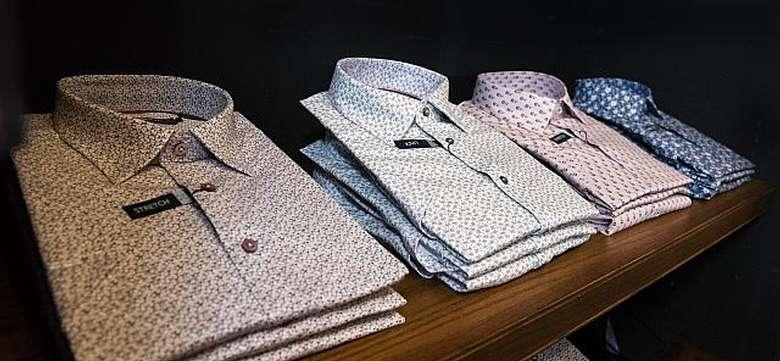 shirts folded on shelf