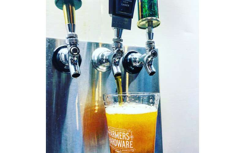 beer being poured from tap into glass