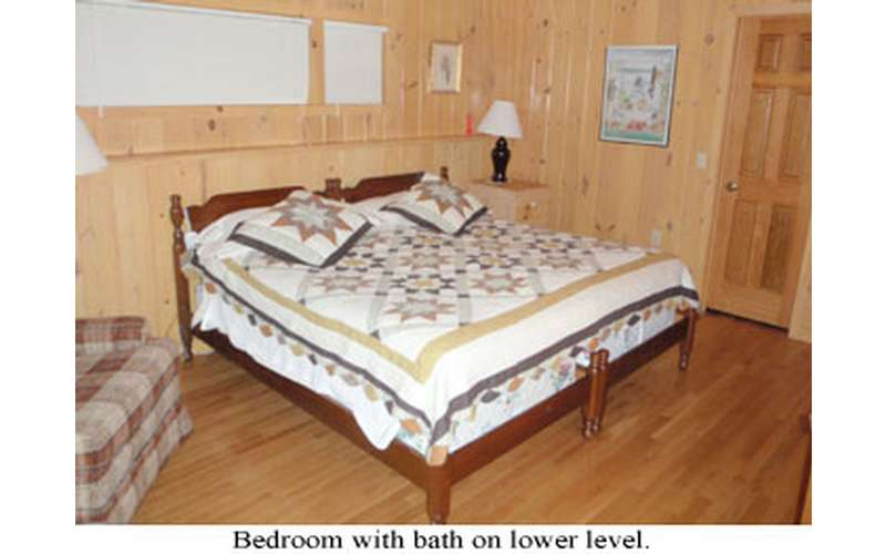 a bed in a wood paneled room