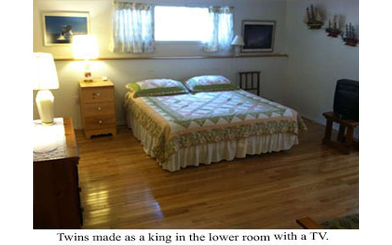 a bed with a window above it