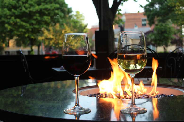 Two wine glasses in front of fire