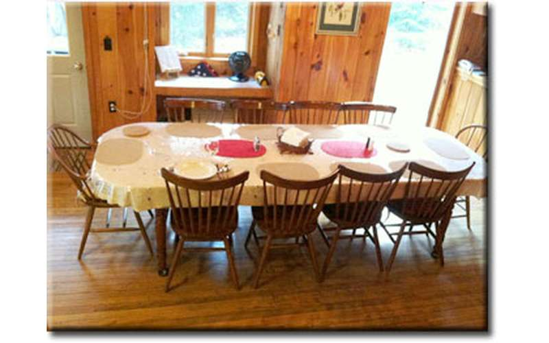 a dining table with ten chairs around it