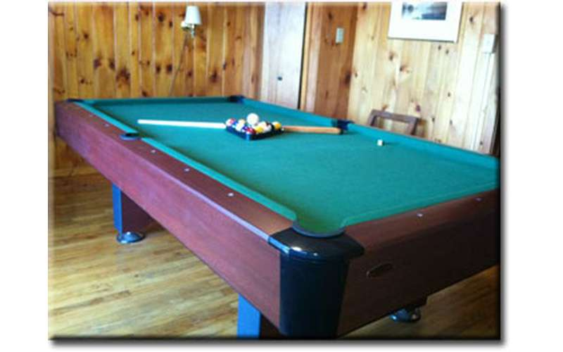 a pool table with pool balls on it