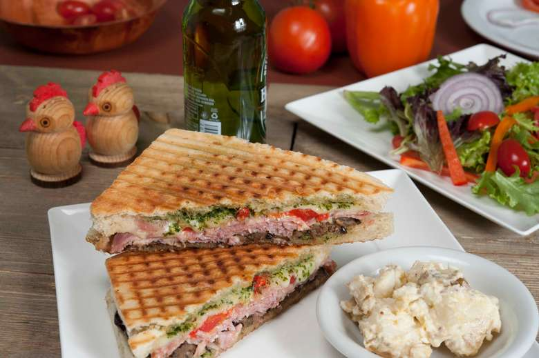 grilled panini with a side of potato salad