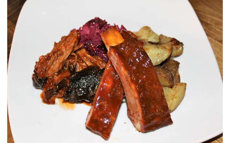 ribs and potatoes on a plate