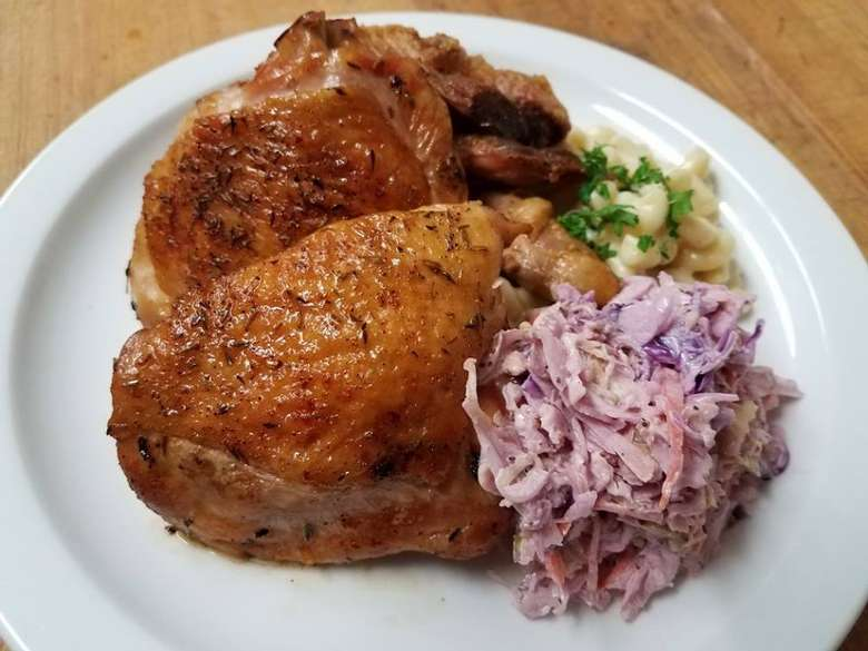 chicken dinner with sides on a plate