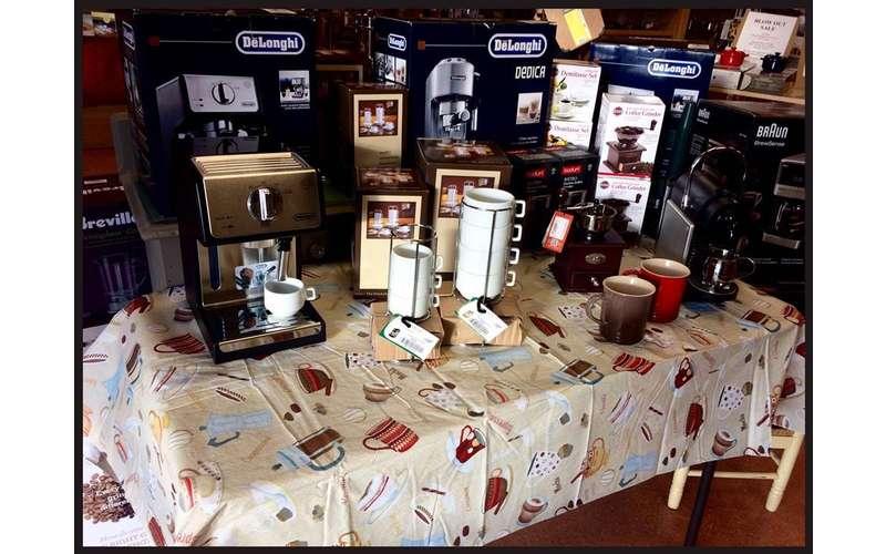 delonghi brand espresso makers on a table
