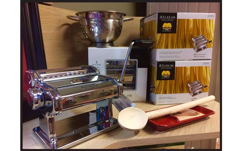 a pasta maker on display with its box