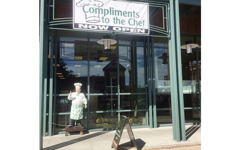 the entrance to the kitchen store named Compliments to the Chef