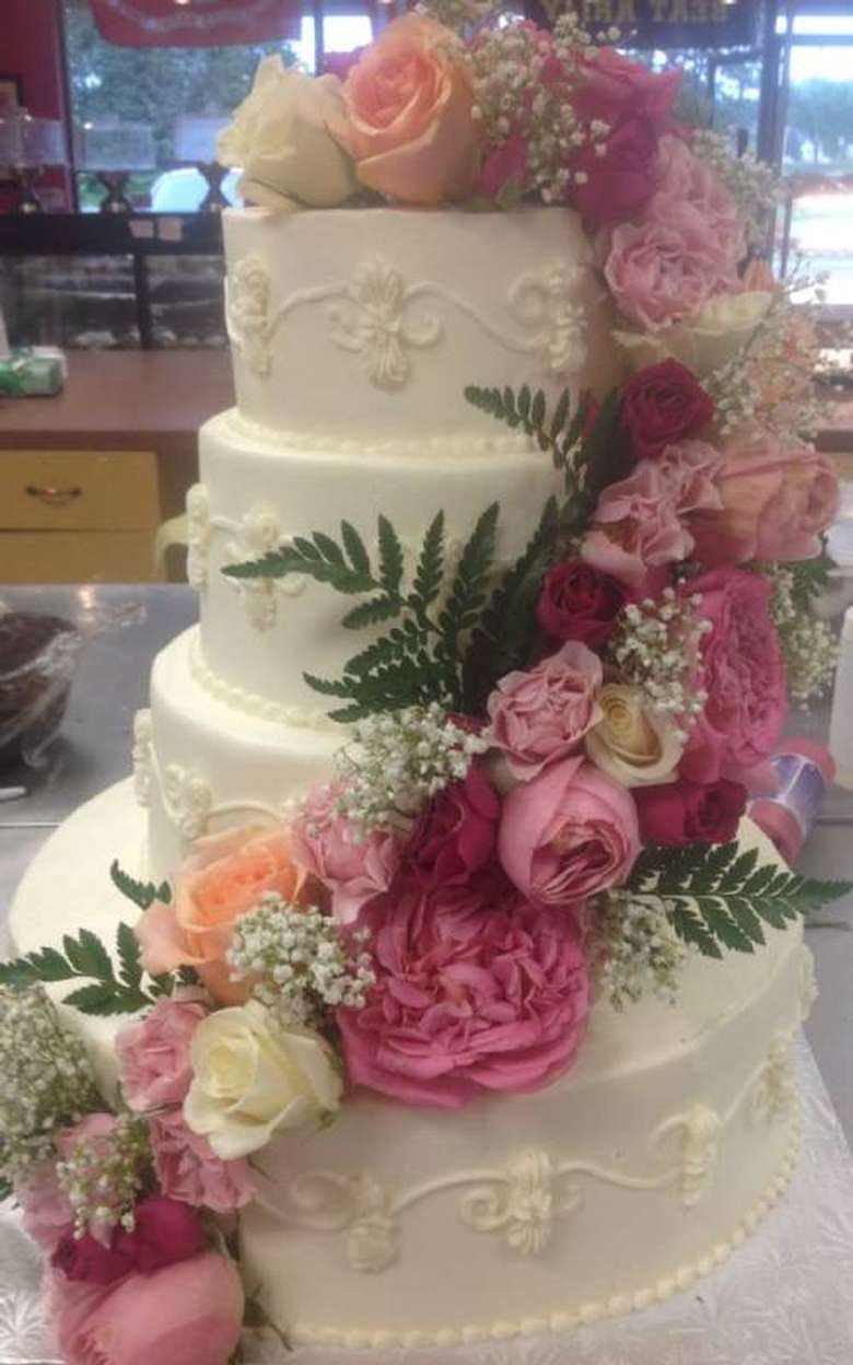 a wedding cake with a floral design