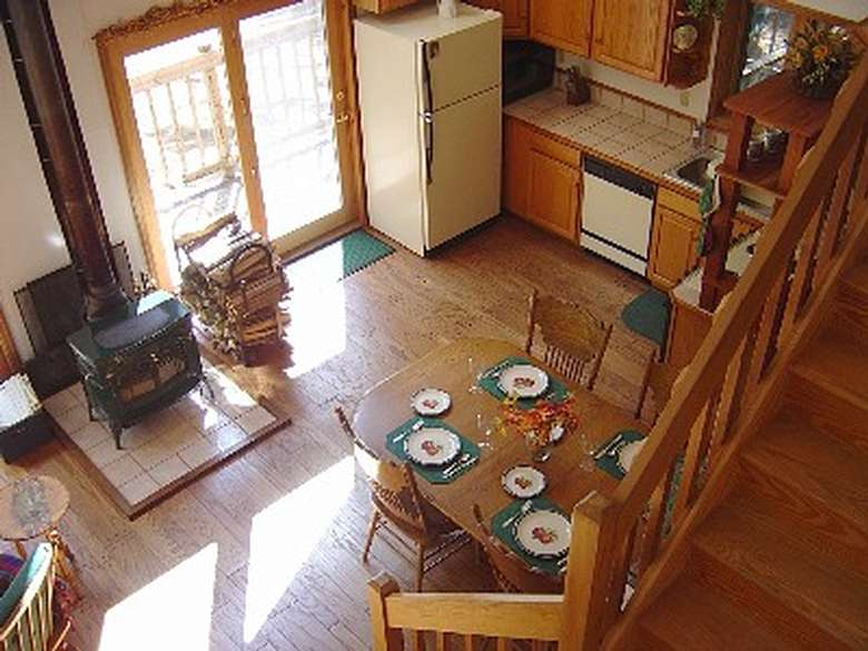 a kitchen near the dinner table and a wood-burning stove