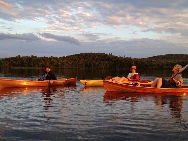 three kayakers on a lake