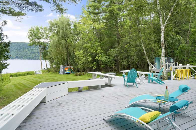 a spacious deck with a view of the lake