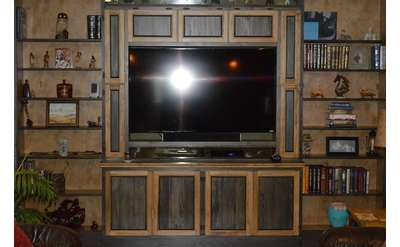 an entertainment center with a TV in the center