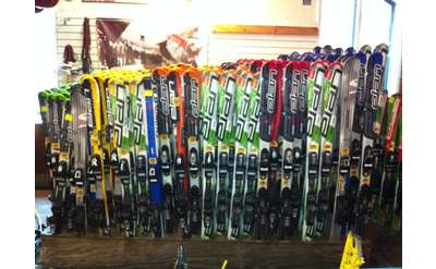 a long rack of skis