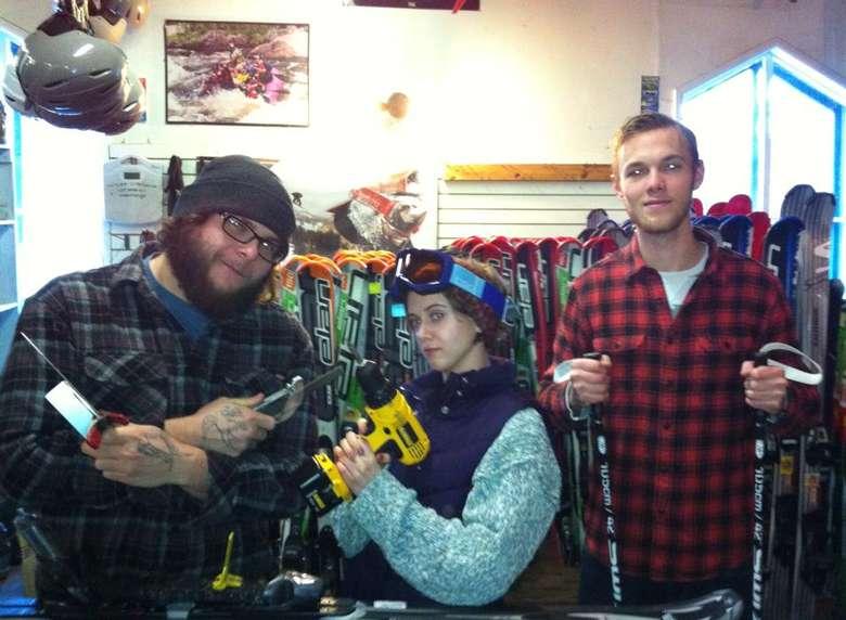 three people inside a ski shop