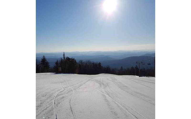 white snow on the ground and ski marks