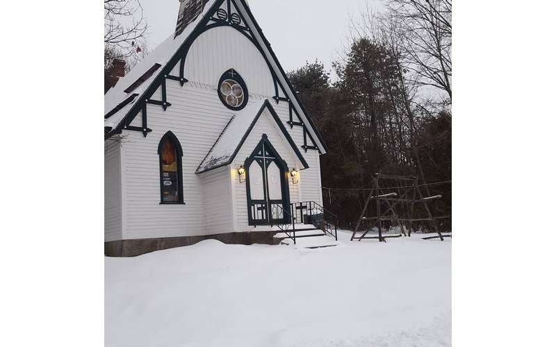 a big white church during the winter