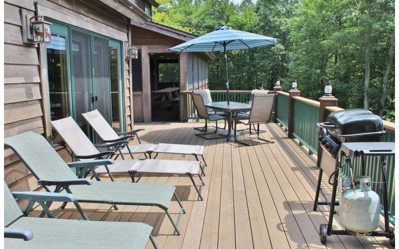 sun chairs on a spacious patio deck