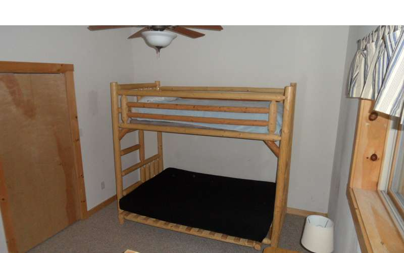 bunk beds with the bottom as a futon