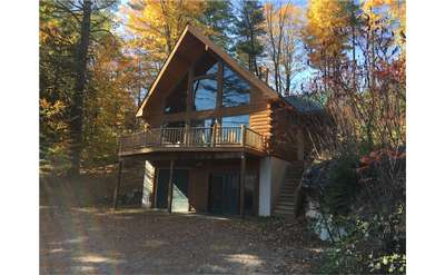 the outside of an Adirondack-style vacation rental home