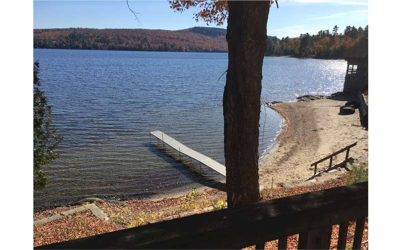 a view of the backyard beach and dock