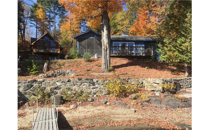 the back of the house in the fall with a dock