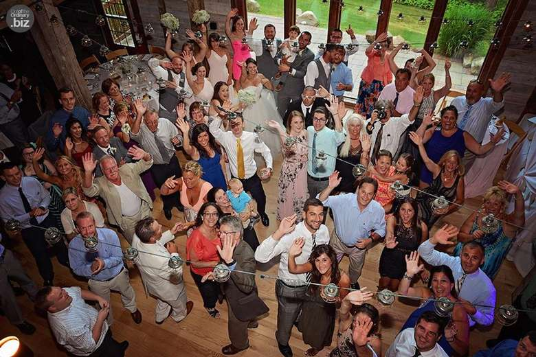 large crowd of people at a wedding party