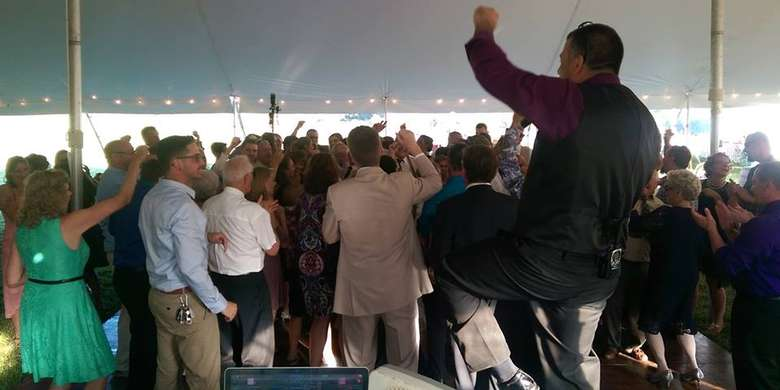 a Master of Ceremonies cheering near a crowd