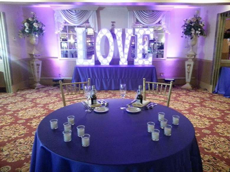 a giant love sign with a table up front