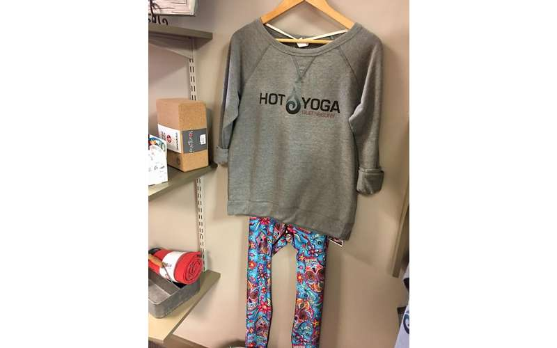yoga outfit hanging on hanger, shirt says Hot Yoga Queensbury