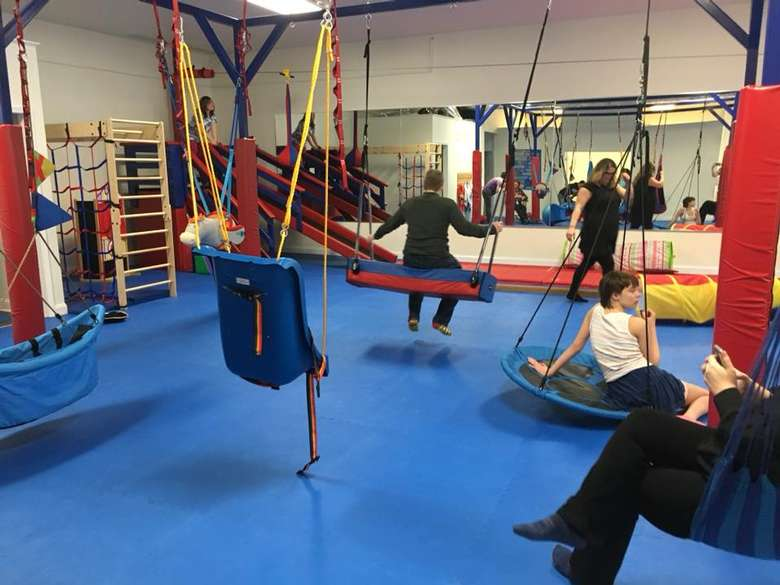 indoor playground with kids on different equipment
