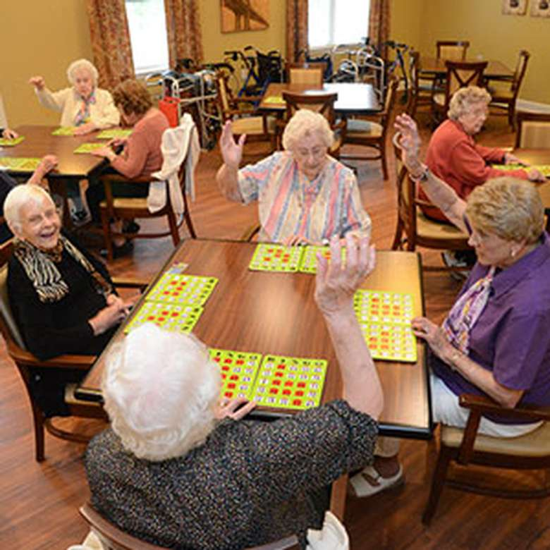 four elderly women playing Bingo