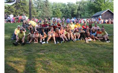 large group photo of campers and counselors on the lawn
