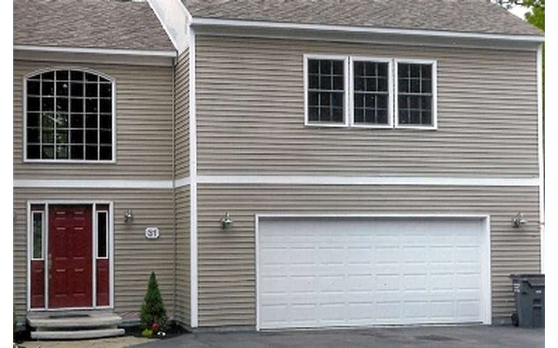 a two story house with a garage on one end