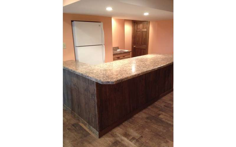 an empty countertop in a kitchen area that is being built