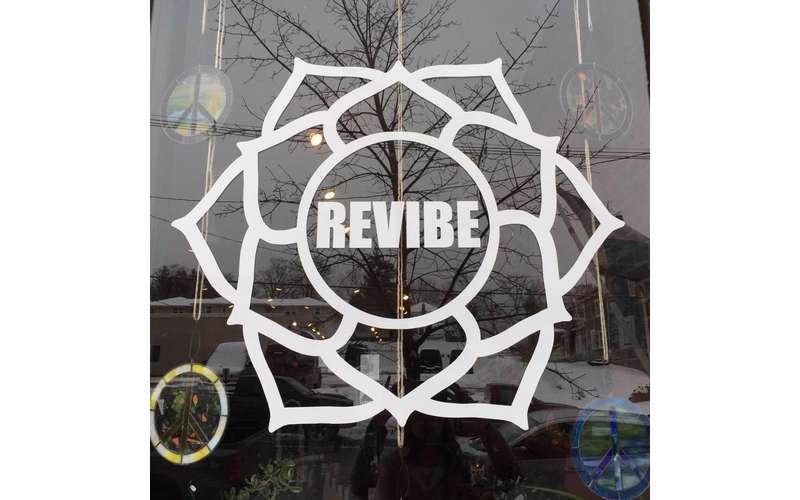 Revibe logo on a window