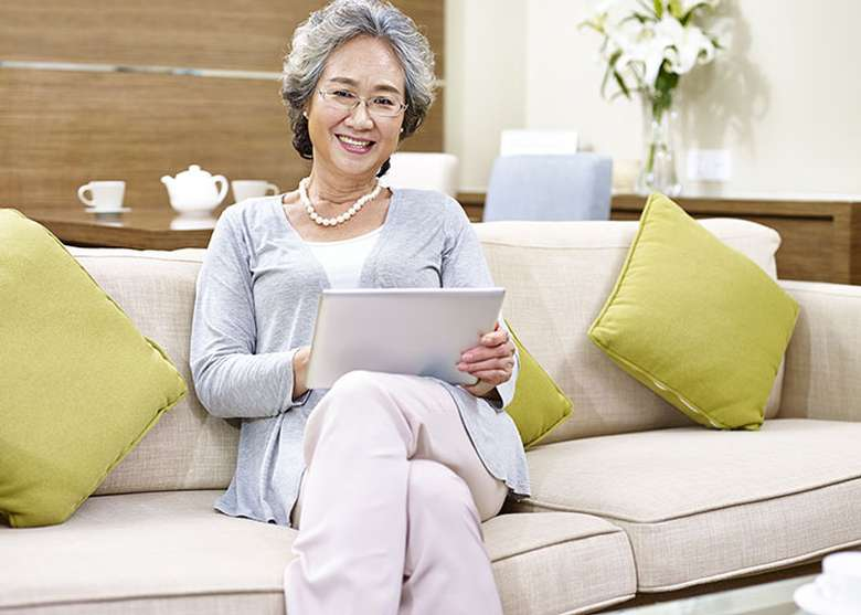 an elderly woman sitting on a couch