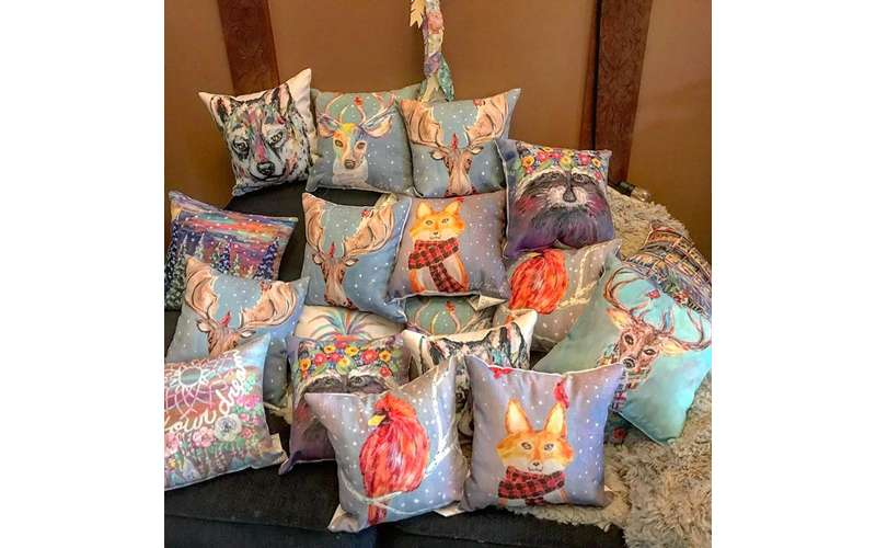 multiple pillows with painted prints on them