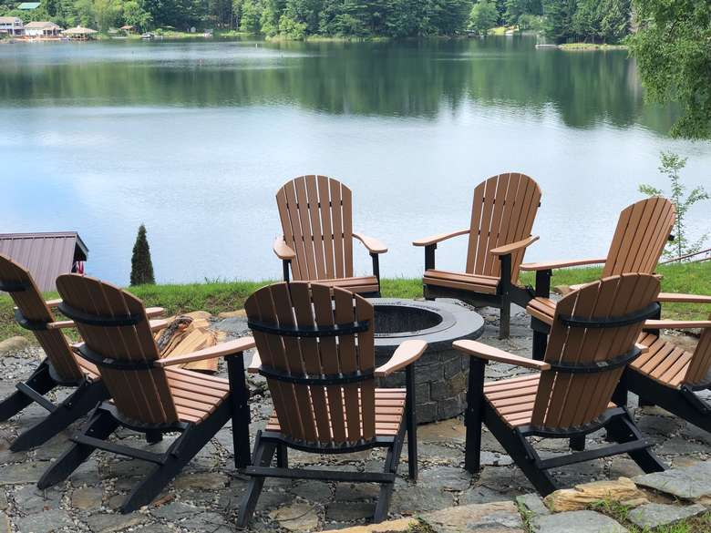 adirondack chairs surrounding a fire pit