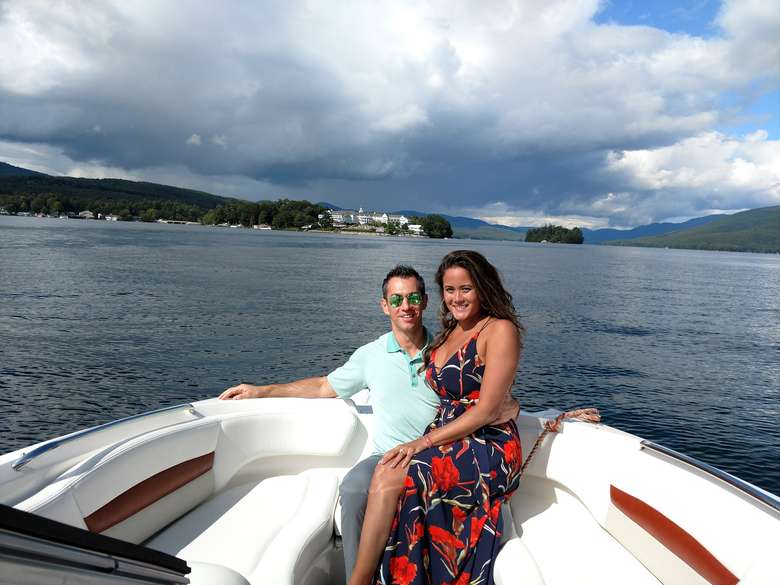 couple posing in the back of a boat