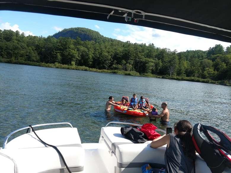 group of people tubing in log bay