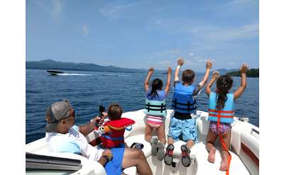 four kids on a boat on Lake George