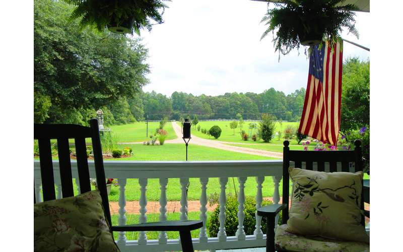 view of a large plantation property from a deck