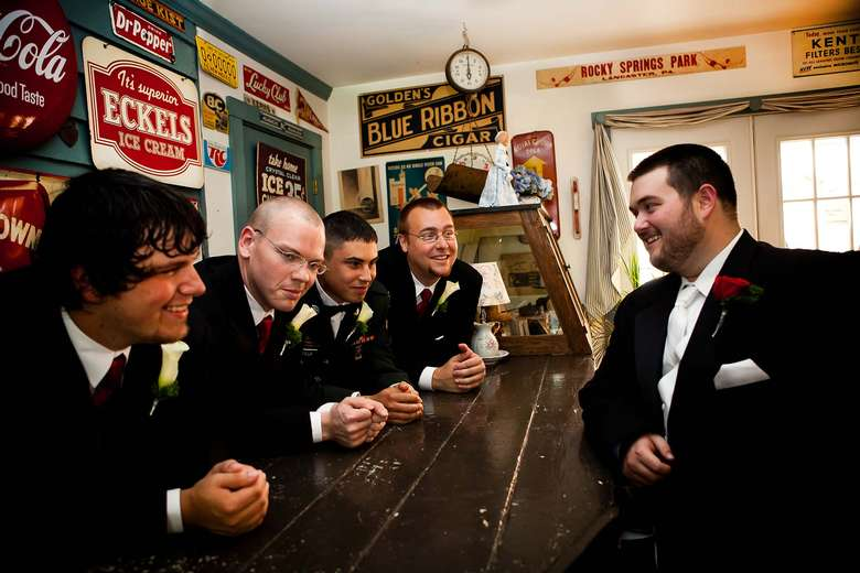 five men dressed up in black suits