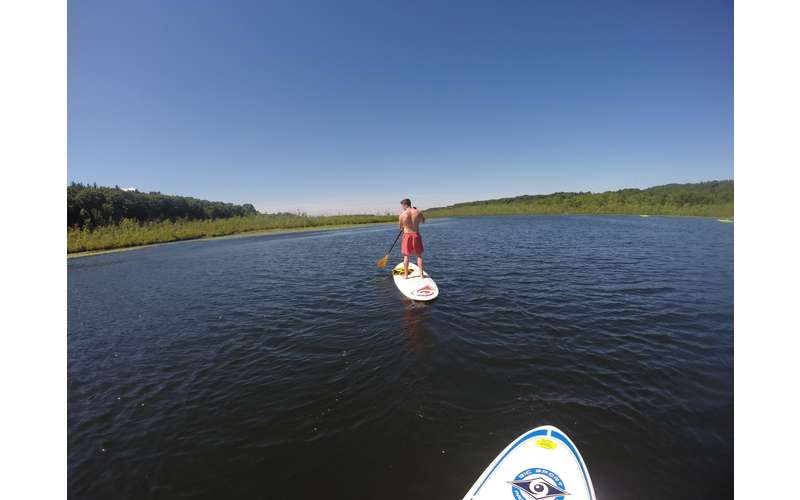 a person in the distance stand up paddle boarding