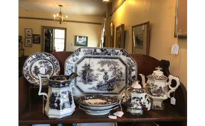 a variety of decorated pottery and dinnerware