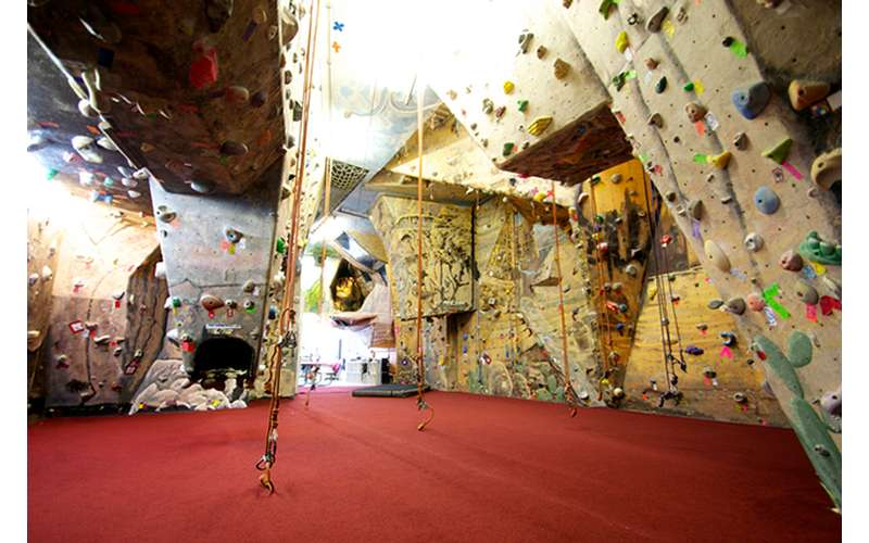 a large indoor rock climbing space